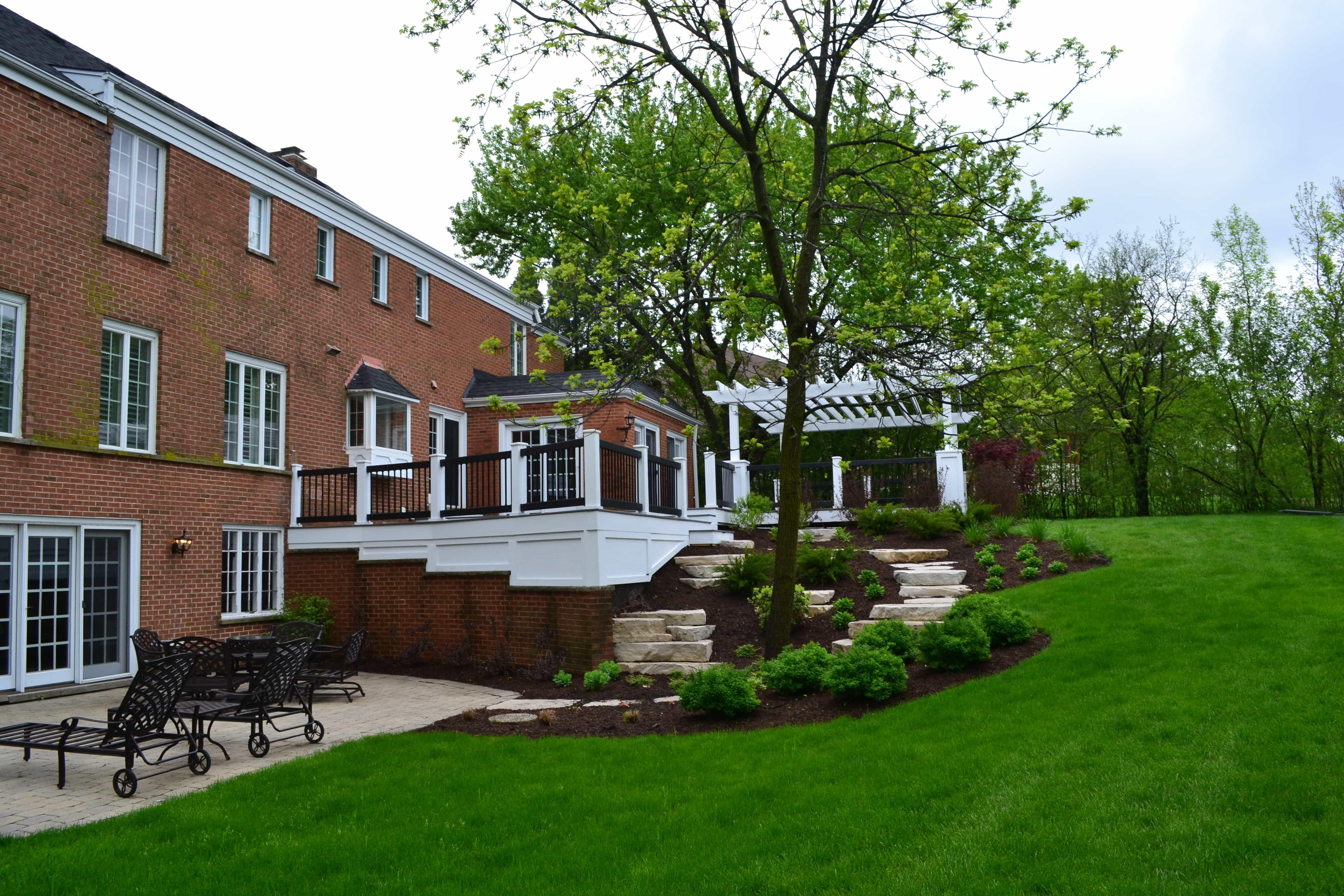 Deck, Pergola With Outcropping Stone & Terraced Landscape Barrington, IL