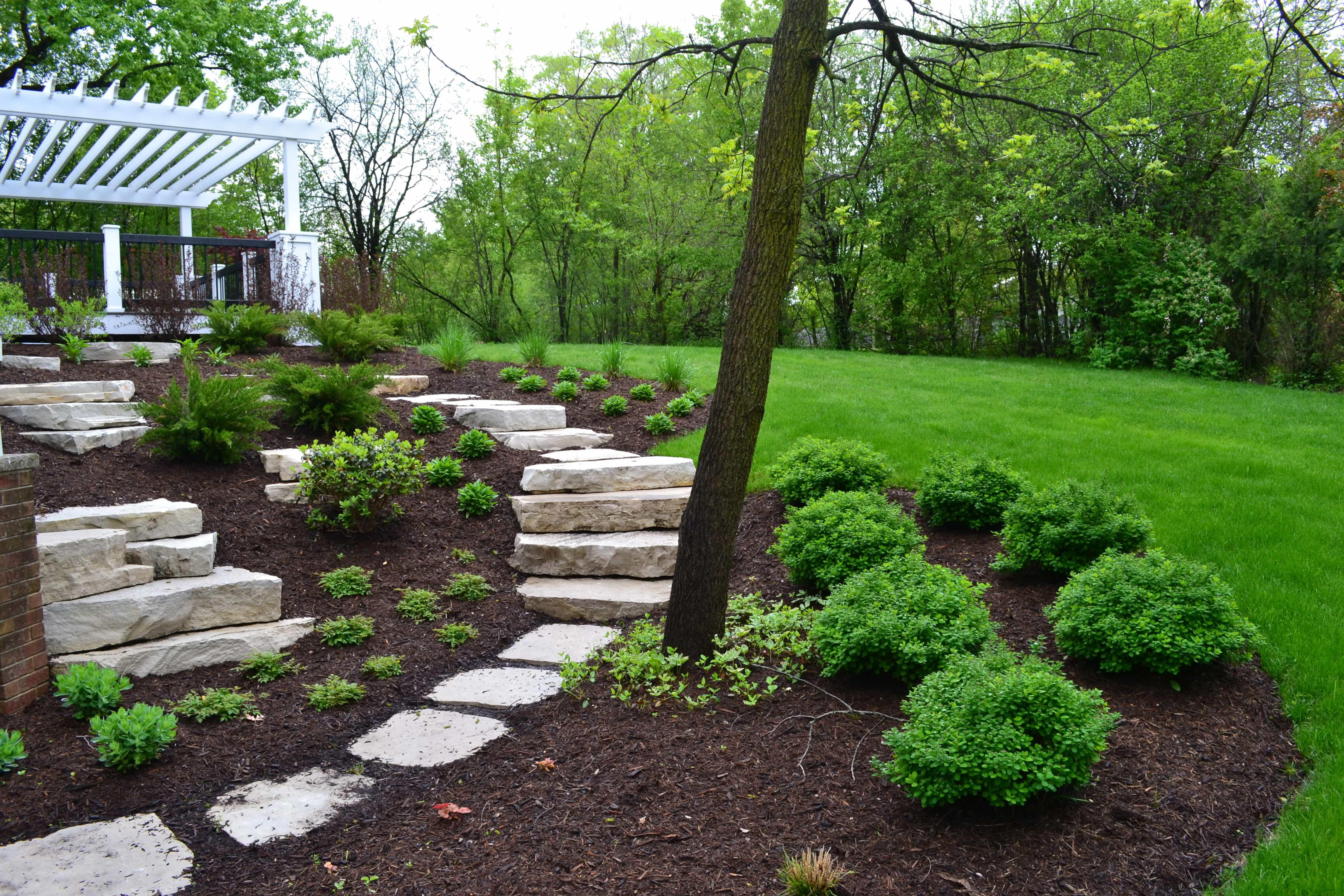 Deck With Pergola, Outcropping Stone Steps & Flagstone Steppers