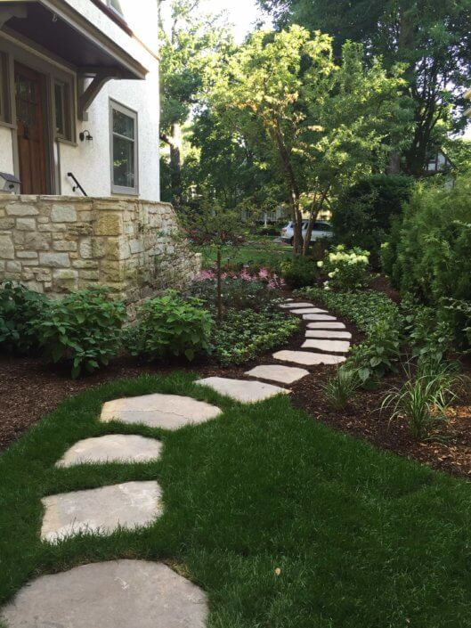 large flagstone steppers with perennials and flowering shrubs The Cage Wilmette IL