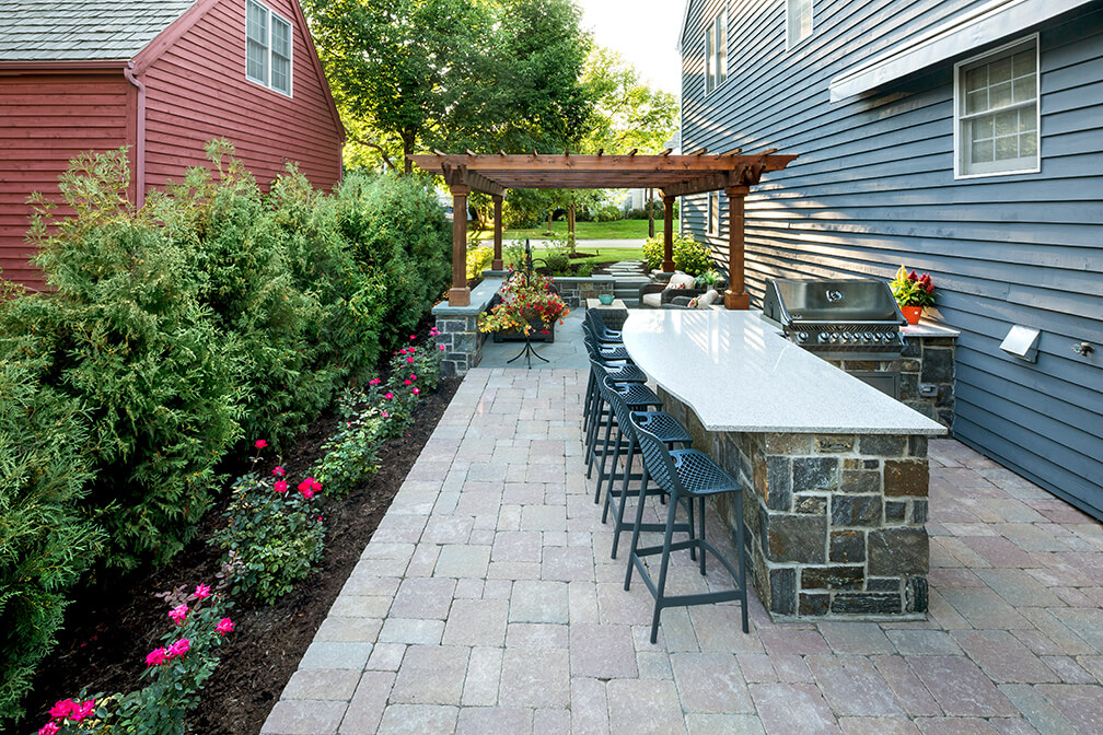sunken bluestone patio american granite retaining wall pergola LED lighting Providence Oaks Gurnee IL