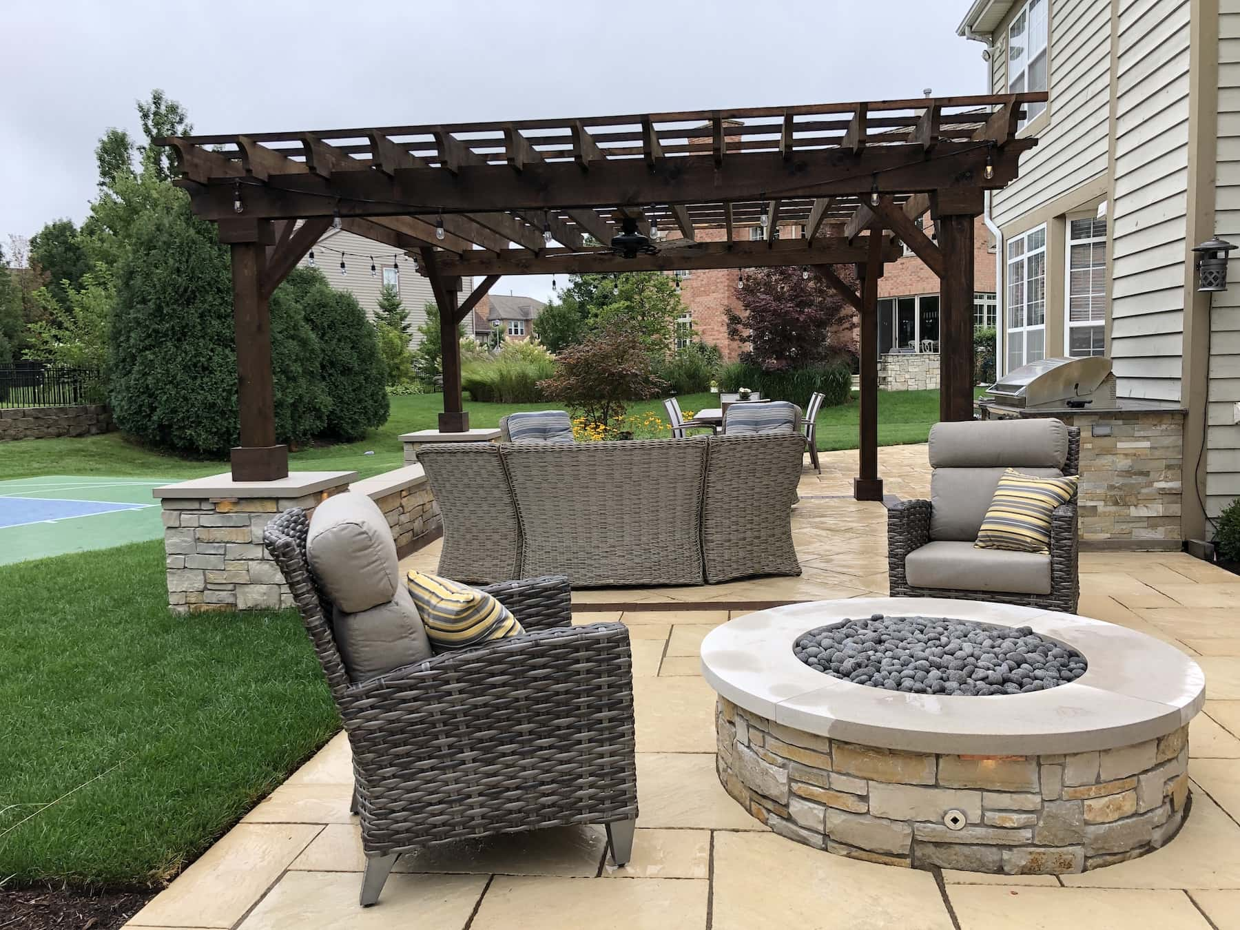 cedar sawn pergola stone paver patio fire pit landscaping outdoor dining northbrook il